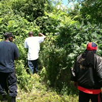 East Cleveland Search Men comb through the brush, looking for the worst.