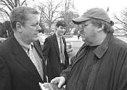 Michael Moore (right) talks with Congressman John - Tanner (D-TN) on Capitol Hill.