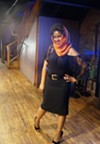 Model backstage wearing a scarf by Tashawna.