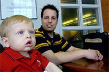 PHOTO BY WALTER NOVAK - Nathan Humrighouse with son Trenton. Nathan was accused of child abuse when Trenton suffered a brain injury in a fall.