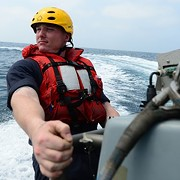Navy Petty Officer 2nd Class Brandon Foor from Lorain in the Arabian Sea: Photo of the Day