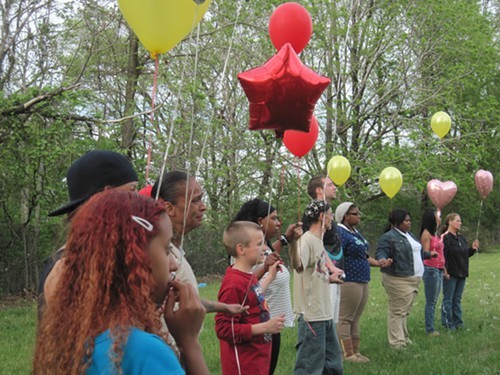 Neighbors gather to release balloons in honor of Michelle Knight and all victims of tragedy.