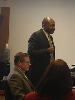 City COO Darnell Brown, approaching the conference table to answer some nitty gritty questions of curious council members. - SAM ALLARD / SCENE