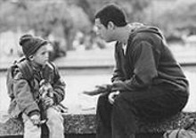 One of the Sprouse twins coaches Adam Sandler through a scene in Big Daddy.