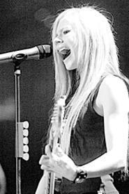 Open wide: Avril Lavigne at the CSU Convocation - Center, November 5. - WALTER  NOVAK