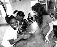 Osterland's classroom assistant Santina Protopapa - (right) helps Doniesha Kinney, Samantha Childs, and - Destiny Sutphin (from left) transform clay into art. - WALTER  NOVAK