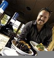 Owner Raphael Vaccaro shows off his standout Duxbury mussels and grilled salmon. - WALTER  NOVAK