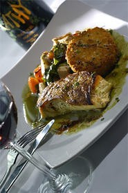 Pan-roasted halibut swims in a seductive m?nge of flavors. - WALTER NOVAK