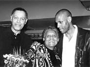 Partners in protection: J. Brown (right) and his parents, Malcolm and - Ernestine