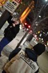 Pete Eyre photographs Jacob Frost under a surveillance post in Public Square.