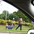 Pic: Just a Shirtless Dad With a Rifle and His Kids Walking in Medina