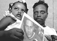 WALTER  NOVAK - Reggie Brown's death left Jakimah Dye alone with their daughter, Janiyah.