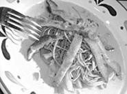 Ribbons of calamari on a bed of soba noodles and stir-fried vegetables just plain rocked. - WALTER  NOVAK