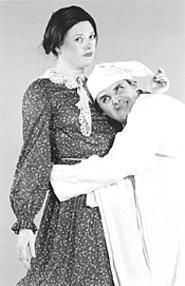Scrooge seeks a little lovin' from Mrs. Bob Cratchit.
