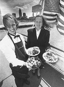 Ship of foods: Seafaring server Laura Spada (left) with Nautica Queen Restaurant Manager Roxane Dotson.