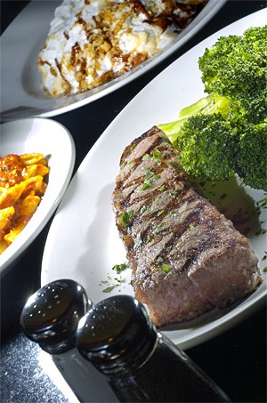 Sink your chops into a juicy New York Strip, one of this Big City's best bets. - WALTER NOVAK