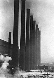 """Smokestacks, Otis Steel Company"" (detail), by Margaret Bourke-White, gelatin silver print."