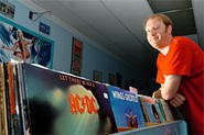 Store owner Jon Mack hawks used vinyl at Hodad's Music in Lakewood. - WALTER NOVAK