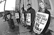 Striking Vindicator workers somehow managed - to keep their new favorite word -- scab! -- off - their picket signs. - WALTER  NOVAK