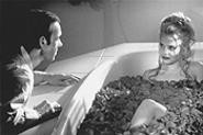 Sweet dreams: Lester (Kevin Spacey, left) draws a bath for Angela (Mena Suvari).