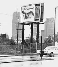 Tape up or ship out: Eller Media says the city's crackdown on torn billboards is political retaliation. - WALTER  NOVAK