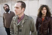 Ted Leo (center) goes nowhere without his two pharmacists.