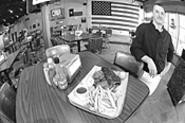 That trayful of food next to Chef Jacob Westervelt is - the Cowboy combo: Ribs, pulled pork, brisket, fries -- - the works. - WALTER  NOVAK