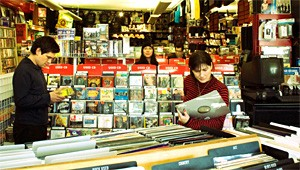 The Breeders try to track down a cheap used copy of Surfer Rosa for the road.
