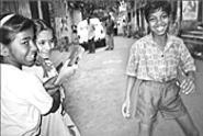 The children's smiles betray their often hellish - environs.