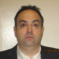 The Brothel of Bedford: The Mugshots and Inside The Office Space The law director's booking photo after his corruption arrest.