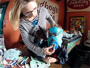 The next generation of Los Straitjackets fans made their own masks for the band's all ages show at the Beachland. - WANDA SANTOS-BRAY