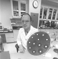 They're alive: Dr. Michael R. Jacobs and his antibiotic-resistant bacteria. - WALTER  NOVAK