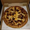 Thick pizza dough is topped with mustard and ketchup as a base. Then full size hamburgers are topped with American cheese and loads of bacon. Sorry no fries. A Slice Above Pizza is located at 8788 Pearl Rd , Strongsville. Call 440-826-1300 or visist asliceabovepizza.com for more information.