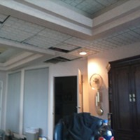 The Brothel of Bedford: The Mugshots and Inside The Office Space This picture, obtained from a Scene source, shows Jim Walsh's office directly after the raid. Heroin was kept in the ceiling, according to another source.
