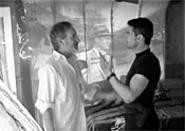 Tom Cruise and Steven Spielberg have a close encounter (oh, so ugh) on the set of Minority Report. - DAVID  JAMES