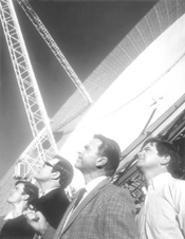 Tom Long, Patrick Warburton, Sam Neill, and Kevin - Harrington (from left) cast their gaze skyward.