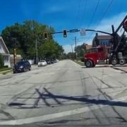 Watch This Dump Truck Get Stuck Under a Lakewood Traffic Light
