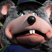The Tragic Backstory Behind Chuck E. Cheese's New 'Premium' Takeout Pizza