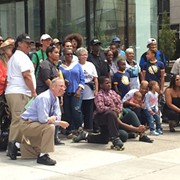 Group of Mostly Black Detroit Residents Takes Photo at Site of Dan Gilbert's Controversial Ad