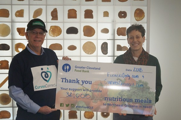 """FarmersOnly.com founder Jerry Miller presenting """"giant check"""" to the Food Bank's Joanne Clemens. - SAM ALLARD / SCENE"""