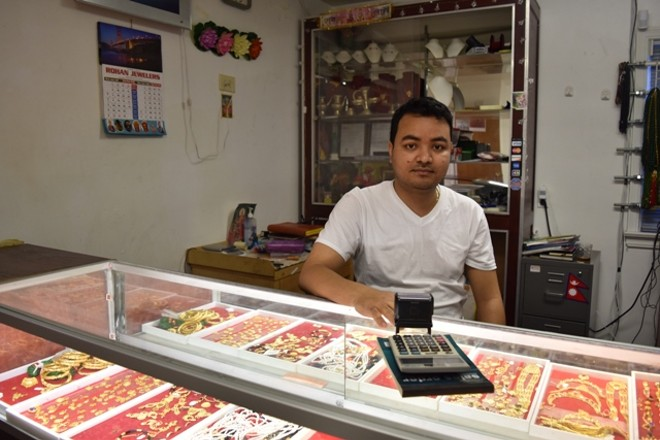 BHAKTI GAJMER SPENT 17 YEARS IN A REFUGEE CAMP IN NEPAL. HE NOW OPERATES AKRON'S ROHAN JEWELERS WITH HIS BROTHER BINOD. (ROYZMAN)