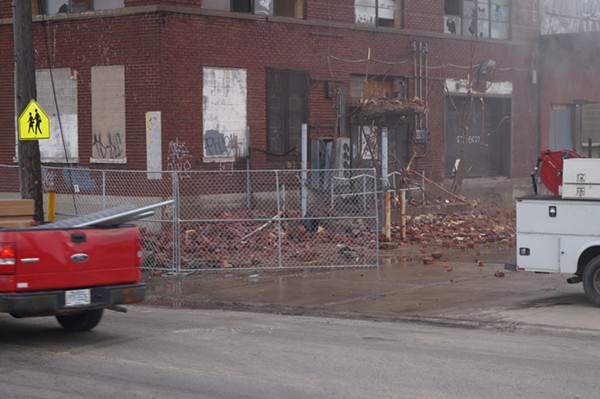 Bricks and other debris begin to pile up / Phase one Demolition of Swift & Co. meat packing building (3/20/18). - SAM ALLARD / SCENE