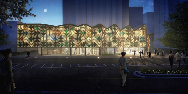An exterior night view of the MASS & LDA proposal for the Cleveland Public Library's new Martin Luther King Jr. Branch as viewed from across Euclid Avenue east of East 105th Street. - MASS & LDA