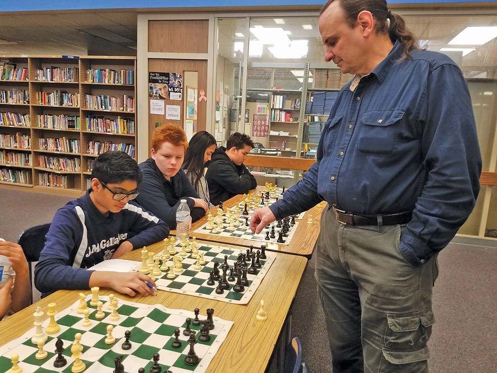 Local chess master Steven Seward plays simultaneous games with the team, - but Nouh Shaikh is a worthy challenger. - PHOTO COURTESY OF AMIT GHOSE