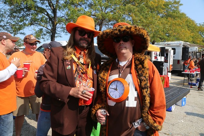 Some Browns fans showing off their best stuff in the Muni Lot. - PHOTO BY EMANUEL WALLACE