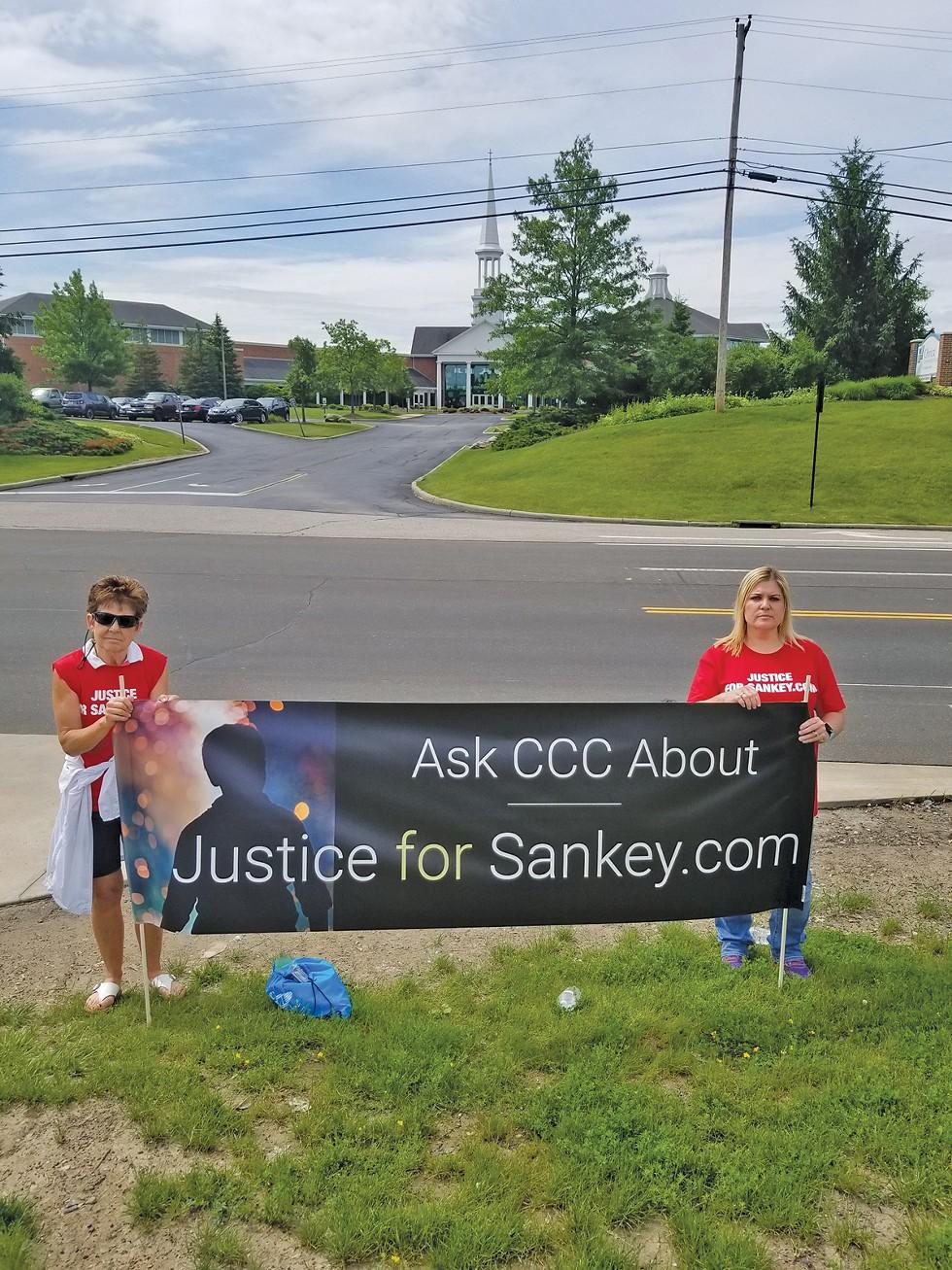 Cari Gintz and Sarah Klingler outside Christ Community Chapel in June. - PHOTO COURTESY SARAH KLINGLER