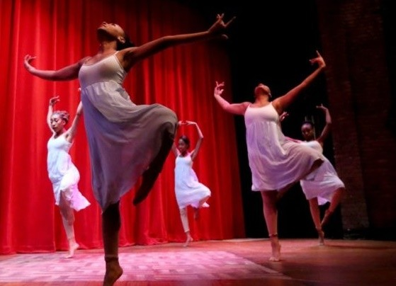 31ec2d0d_women_dancing_on_stage_karamu_theatre.jpg