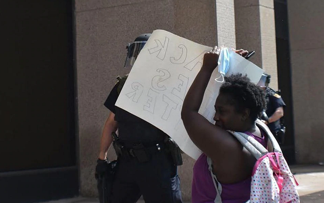 PHOTO INCLUDED IN FEDERAL LAWSUIT OF JALEESA BENNETT TRYING TO USE A SIGN TO PROTECT HERSELF FROM PEPPER SPRAY