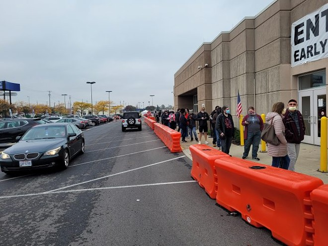 Hundreds line up outside the Franklin County Board of Elections office Tuesday waiting to cast early ballots. Officials there say that despite delays 50,000 voters who received absentee ballots will be counted. - PHOTO BY MARTY SCHLADEN, OHIO CAPITAL JOURNAL.