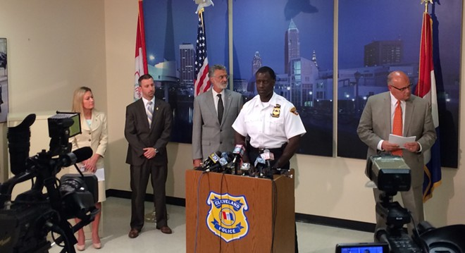 Cleveland police chief Calvin Williams, center, at a press conference - ERIC SANDY
